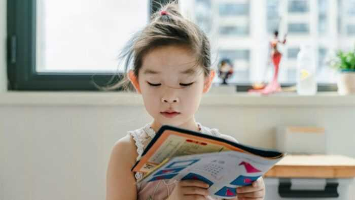 children reading picture book by themself